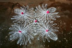 Rangoli. Is art of drawing designs using stone powder and decorating with flower petals Stock Image