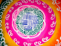 Rangoli Background. A background with a view of an artistic design made of rangoli (colored powder art in India Stock Photography