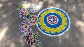 Rangoli. Beautiful rangoli new design color use blue red green yellow pink etc Royalty Free Stock Image
