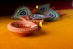 Rangoli design around Diwali lamp Royalty Free Stock Photography