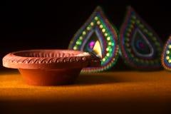Rangoli design around Diwali lamp Royalty Free Stock Image