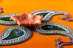 Rangoli design around Diwali lamp Stock Images
