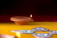 Rangoli design around Diwali lamp Royalty Free Stock Photos