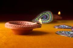 Rangoli design around Diwali lamp Royalty Free Stock Photo