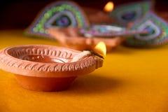 Rangoli design around Diwali lamp Stock Photography