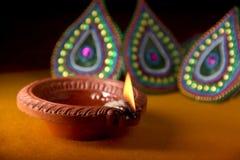Rangoli design around Diwali lamp Royalty Free Stock Images