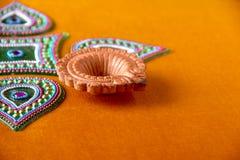 Rangoli design around Diwali lamp Stock Photos