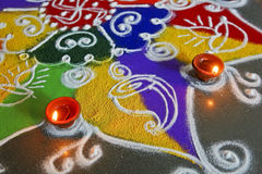 Rangoli and Diva Abstract. Drawn drawn by sprinkling colored powders, rangoli are a custom in hindu household during divali and festive occasions for example new Royalty Free Stock Photography