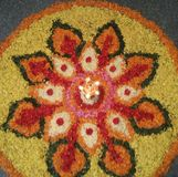 Rangoli. With flower petals with diya in Pongal festival Stock Photo