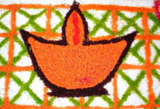 Rangoli of a lamp & x28;diya& x29;. Made from colored rice Royalty Free Stock Images
