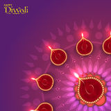 Rangoli with Lit Lamps for Diwali Celebration. Illuminated Lit Lamps on beautiful floral Rangoli, Elegant Greeting Card, Creative Diwali Festive Background Royalty Free Stock Photo