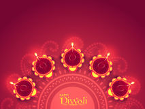 Rangoli with Lit Lamps for Diwali Celebration. Illuminated Lit Lamps on beautiful floral Rangoli, Elegant Greeting Card, Creative Diwali Festive Background Royalty Free Stock Photos
