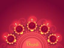 Rangoli mit Lit-Lampen für Diwali-Feier Lizenzfreie Stockfotos