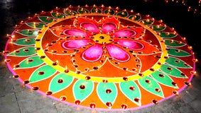 Rangoli. A mix of paint and rangoli with diya decorations for diwali Royalty Free Stock Image