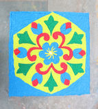 Rangoli. Top view of colourful rangoli design symbol made of soil colours isolated stock illustration