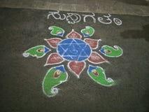 Rangoli. Welcome rangoli with star for function colour Stock Photos