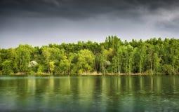 Rani over green lake at dusk Royalty Free Stock Photos