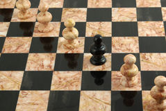 Rank of white and black pawns Stock Image