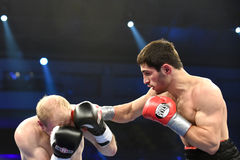 Ranking boxing fight in Palace of sport. Kyiv, UKRAINE - December 13, 2014 : An unidentified boxers in the ring during fight for ranking points in the Palace of stock images