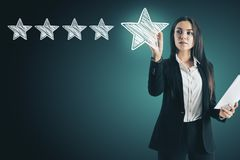 Ranking and champion concept. Attractive european woman drawing abstract star rating stock image