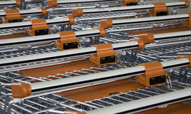 Ranks of shopping carts. Close up of ranks of tightly packed empty shopping carts Royalty Free Stock Photo