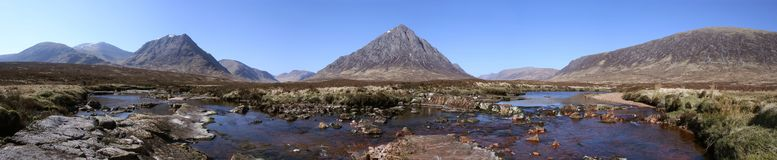 Rannoch panorama. The majectic Stob Dearg peak of Buachaille Etive Mor dominates this panorama looking over Rannoch Moor with River Etive in the foreground royalty free stock photography