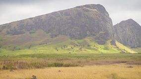 Rano Raraku volcano, the quarry of the moai with many uncompleted statues. Rapa Nui National Park, Easter Island, Chile. UNESCO W. Orld Heritage Site. Island stock photography