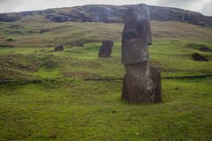 Rano Raraku volcano, the quarry of the moai with many uncompleted statues. Rapa Nui National Park, Easter Island, Chile. UNESCO W. Orld Heritage Site. Island royalty free stock image