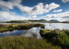 Ranoch moor. Loch on Ranoch Moor with mountains royalty free stock photos