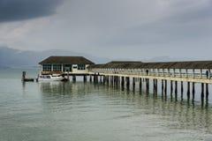 Ranong pier light house and cumulonimbus Royalty Free Stock Photography