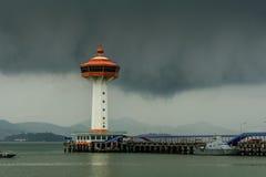 Ranong pier light house and cumulonimbus Royalty Free Stock Image