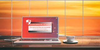 Ransomware attack on a laptop screen. Blurred sunset background. 3d illustration. Laptop with cyber ransomware screen and silver color placed on a wooden desk Royalty Free Stock Image