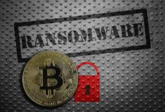 Ransomware bitcoin concept. Ransomware stamped on metal with red lock and a bitcoin Stock Photography