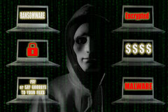Ransomware Concept : Hacker with notebook computer showing sign Stock Images