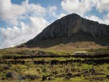 Ranu Raraku And Camper Van. A camper van parked in front of the side of Ranu Raraku, the nursery on Easter Island Stock Images