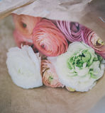 Ranunculus bouquet on craft paper Royalty Free Stock Photos