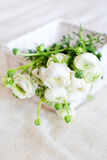 Ranunculus flowers. Lie in white basket royalty free stock image