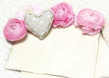 Ranunculus flowers, paper and heart background Royalty Free Stock Photography