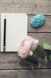 Ranunculus and paperweight over wood table top Royalty Free Stock Photos