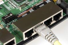 Ranurador y cable de Ethernet Foto de archivo libre de regalías