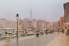 Rany day in old town Rovinj Stock Images