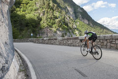 Raod bicycle woman. Woman road cycling in the mountains Royalty Free Stock Images