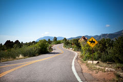 Raod and mountains for background. Road in national park Garden of the Gods Stock Image