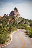 Raod and mountains for background. Road in national park Garden of the Gods Royalty Free Stock Images