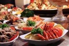 Raohe Night Market. Taiwan night food market - Raohe Night Market in Taipei. Seafood plates with shrimp, octopus and fish royalty free stock image