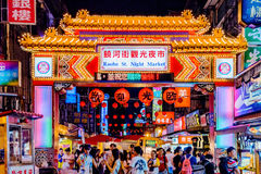Raohe street night market. TAIPEI, TAIWAN - JUNE 19: This is the entrance to the famous Raohe street night market where many tourists and locals go to try famous Royalty Free Stock Photos