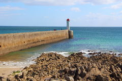 Raoulic lighthouse in Audierne. Raoulic lighthouse and breakwater in Audierne Stock Photo