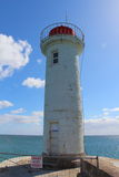 Raoulic lighthouse in Audierne. Raoulic lighthouse on the breakwater in Audierne Stock Images