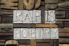 Rap is poetry. Phrase made from metallic letterpress blocks in mixed wooden letters stock images