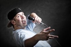 Rap singer man with microphone cool hand gesture Royalty Free Stock Photo
